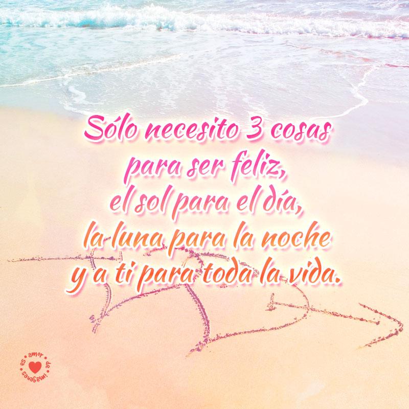 corazones-flechados-en-la-arena-junto-al-mar-y-bello-mensaje-de-amor